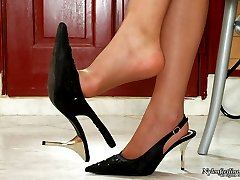 Sexy babe licking sticky juice from her yummy feet clad in soft silky hose