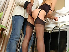 Cutie in black stockings savoring taste of sheer nylon before riding on top