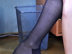 Blonde office girl changes her ripped stockings for a new black FF pair