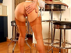 In her British suntan point heel full fashioned nylons, and slinky white sheer nylon panties,...