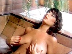 Busty retro hottie playing
