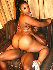 Busty ebony Chyna T shows off her plump ass before she rides a huge dick on the sofa