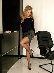Leggy Kathryn shows her gorgeous black nylon legs and tall shiny stilettos, as she struts around the office