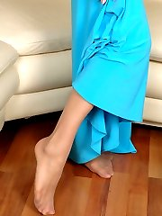 Awesome chick in slight sheen pantyhose indulging her lust in footsy games