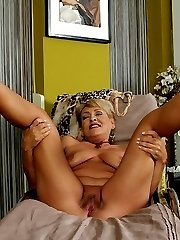 Curvy older wife Andrea strips butt ass naked.