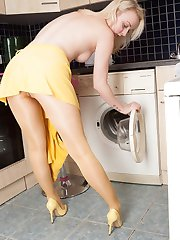 Sexy blonde babe Kiana is messing about in the kitchen, getting wet, stripping of and playing...