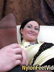 Lusty gal in reinforced toe tights going for a hot score after foot-licking