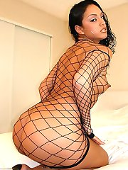 Dark haired slut in a fishnet outfit squeezes her round ass for a fuck