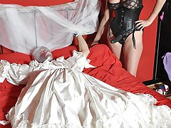 Strapon Jane has this blushing sissy bride exactly where she wants him! On her bed gagging for...