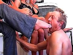 Group foot domination and spanking fun