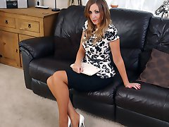 Gorgeous brunette Debbie shows off her amazing legs in a pair of nylon stockings and shiny white...