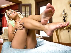 Bridgette B. is one foxy Spaniard, she has golden blonde hair and sexy luscious lips. Amazing tits and a nice tight round ass. But this were focused on her pretty feet. Bridgette is very ticklish when
