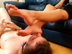A hard whipping treatment turns young slave into much more eager toe licker