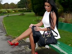 Gorgeous Kerry teases her beautiful silky nylon legs with a pair of red stiletto heels on her...