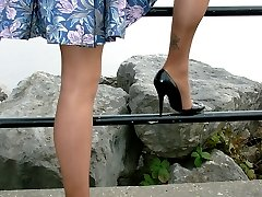 Carrie takes in a stunning view, so why dont you of her? She wearing her silky nylons and black...