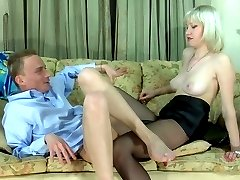 Strap-on armed chick calling in her boyfriend for hard score on the sofa