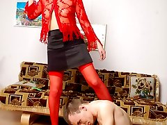 Red-stockinged babe with mighty strap-on is about to drill guy�s banghole