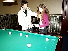 Teen girl is taught to play pool and fuck