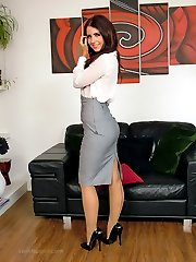 Hot brunette Carla shows off her gorgeous seamed nylons and shiny stilettos around the house, after a hard day at the office