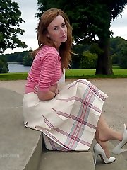 Cute redhead Sophia poses in a lovely white pair of high heel stilettos