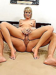 Short haired blonde slut strokes a cock with her pedicured feet