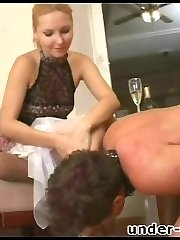 Fleshy slave on a leash gives his lady a tender foot massage