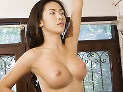 Sumptuous Asian goddess Eiko stripping and showing her perfect big boobs