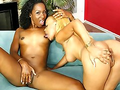 Two black lesbians getting each other off in hardcore action
