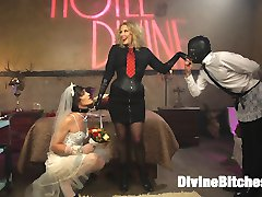 Maitresse Madeline Marlowe brings her new feminized bride to Hotel Divine for their honeymoon...