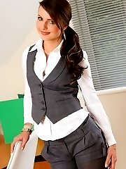 Beautiful secretary removes her shorts and vest to reveal sexy lingerie.