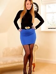 Stunning auburn haired Lacey in miniskirt and pantyhose