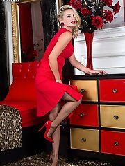 Looking the Hollywood bombshell in a scarlet full skirted frock with matching patent stilettos. Vanessa plays and performs on the bed in sheer fully fashion nylons and retro lingerie.