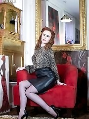 Saucy redhead Ella in racy blouse and leather pencil skirt, sheer black vintage ff nylons and...