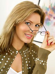 Stunning blonde Nicole in secretary outfit with green pantyhose.