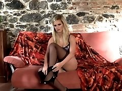 Blonde teasing and stripping in black stockings and heels
