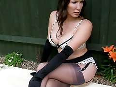 Nylon Jane wearing some naughty spotty lingerie outdoors