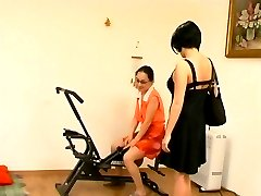 Mature trainer showing a girl in specs some special pussy eating exercises