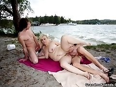 The two young men find the mature babe on the beach and they resolve to screw her hard