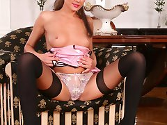Stockinged honey Sweet Nikita strips her pink latex dress and gets anally pounded