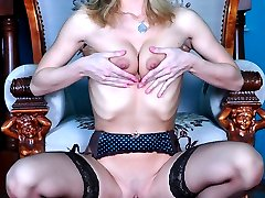 Smoking hot blonde in a leopard dress parts her stockinged legs for a dildo