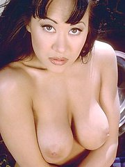 Asia Carrera stripping naked and posing outdoors