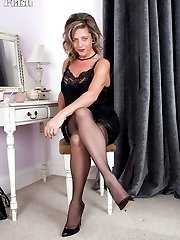 Silky thighs Lou at her dressing table in sexy, glossy black slip!