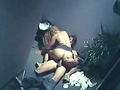 A long haired cutie is bent over and fucked from behind