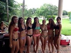Naughty bikini chicks posing sexy in public