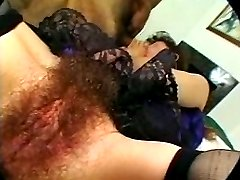 Lustful hairy dark-haired slut sucking two cocks simultaneously