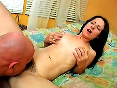 Lena Ramon flaunts her thick bush and lets this guy admire it by licking her pussy lips