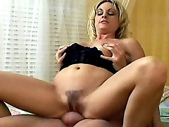 Hairy pornstar Sindy Lange rides on a massives cock while her boobs are getting squeezed
