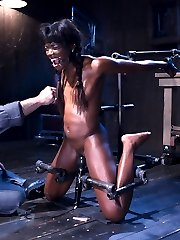 Ebony babe, Ana Foxxx, is put in compromising positions and tormented. She is stretched out with...