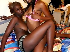 Ebony lesbians put a strap-on to use