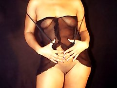 Tracy loves to wear skimpy black see through lingerie that shows off her big black ass. As she...